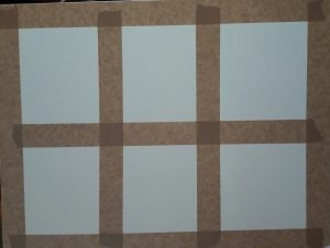 watercolour paper taped into squares
